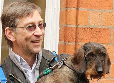 Ian Seath, Chairman of the Dachshund Breed Council, holding a Dachshund